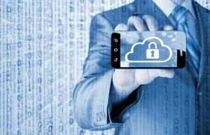 A man holding out a mobile phone for you to look at with an image of a padlock inside a cloud, showing how secure it is.